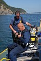 US Navy 060818-N-3390M-015 Chief Warrant Officer Mark Thomas and Hospital Corpsman 1st Class Rod Nudding, assigned to Mobile Salvage Unit One (MDSU-1), dress out in divers gear in preparation retrieving derelict fishing nets.jpg