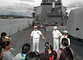 US Navy 061101-N-0879R-002 From the bow of the Pearl Harbor-based guided missile destroyer USS Hopper (DDG 70), students from Aiea High School learn about the ship and the Navy's mission.jpg