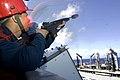US Navy 070613-N-8591H-050 Aviation Ordnanceman 3rd Class Reni Araque fires a MK-87 line from an M-14 rifle aboard USS Kitty Hawk (CV 63) to Military Sealift Command (MSC) fleet replenishment oiler USNS Guadalupe (T-AO 200).jpg
