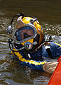 US Navy 070811-N-3093M-005 Chief Navy Diver Scott Maynard attached to Mobile Diving and Salvage Unit (MDSU) 2 from Naval Amphibious Base Little Creek, Va., prepares to leave the surface on a salvage dive in the Mississippi Rive.jpg