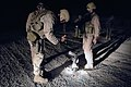 US Navy 070814-N-6794Z-002 Sailors attached to Explosive Ordnance Disposal Mobile Unit (EODMU) 11, Company 9-13, inspect the remnants of a rocket fired by insurgents that landed on Contingency Operating Base Speicher.jpg