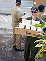 US Navy 071214-N-2398S-082 Cmdr. Charles Groves, commanding officer, Forward Operating Location (FOL) Comalapa, carries medical supplies to Iglesia Nazarret free clinic's storage area.jpg