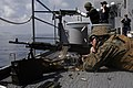 US Navy 080627-M-2564A-005 Cpl. Trever J. Hohman, an amphibious assault vehicle operator assigned to a Marine combat assault company embarked aboard the amphibious assault ship USS Tortuga (LSD 46) opens fire on a pontoon targe.jpg