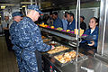 US Navy 081219-N-0803S-006 Chief of Naval Operations (CNO) Gary Roughead, right, and Master Chief Petty Officer of the Navy (MCPON) Rick West serve lunch to Sailors and Marines.jpg