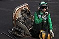 US Navy 081229-N-8822R-059 Aviation Boatswain's Mate (Equipment) Airman Melissa Pyle conducts a communications check on the flight deck of the aircraft carrier USS Theodore Roosevelt (CVN 71).jpg