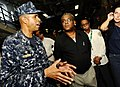 US Navy 100206-N-5345W-083 Capt. Sam Howard, commanding officer of the amphibious assault ship USS Bataan (LHD 5), explains his ship's well deck capabilities to Haitian Prime Minister Jean-Max Bellerive.jpg
