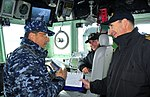 US Navy 100316-N-4774B-829 Capt. Dom DeScisciolo, left, commanding officer of the guided-missile cruiser USS Bunker Hill (CG 52), speaks with Chilean navy ship pilots Lt. Reitschel and Lt. Cmdr. Garlaschi.jpg