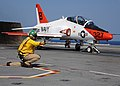 US Navy 100613-N-3885H-377 A shooter launches a T-45A Goshawk from USS George H.W. Bush (CVN 77).jpg