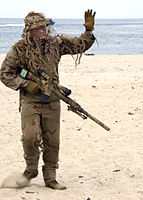 US Navy 100717-N-0683T-292 A U.S. Navy SEAL sniper waves to the crowd during a capabilities demonstration at Joint Expeditionary Base Little Creek, Va