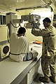 US Navy 101028-N-3887D-029 Petty Officer 2nd Class Jae Yun prepares to take an x-ray of a detainee's foot at the detainee hospital.jpg