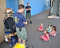 US Navy 110613-N-CD652-063 Chief Navy Diver Kevin Moore talks to a group of girls about the MK-5 diving suit at the Tennessee Aquarium as part of C.jpg