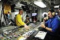 US Navy 110813-N-JO245-024 Lt. Cmdr Eric Harrington shows distinguished visitors from Vietnam the Ouija board in flight deck control aboard the air.jpg