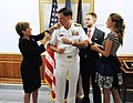 US Navy 110822-N-FC670-051 Adm. Mark Ferguson's wife and children change his shoulder boards during a promotion ceremony at the Pentagon.jpg