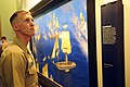 US Navy 110910-N-WP746-084 Hospital Corpsman 3rd Class Lance Easton looks at museum pieces at the Put-in-Bay Visitor's Center.jpg