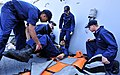 US Navy 110913-N-ZF681-100 Sailors participate in a mass casualty drill aboard the guided-missile destroyer USS Halsey (DDG 97).jpg
