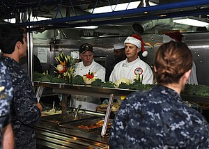 US Navy 111225-N-JN612-098 Christmas dinner served on the mess decks aboard USS Abraham Lincoln.jpg