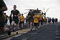 US Navy 120210-N-UE944-010 Sailors and Marines participate in a steel beach 5-kilometer-10-kilometer run on the flight deck of the amphibious assau.jpg