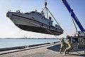 US Navy coastal command boat on crane at Bahrain in 2014.JPG