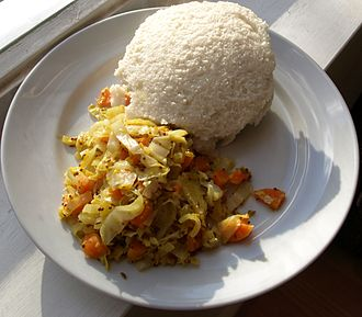African cuisine - Ugali is pictured here with a side dish of cabbage, though it is more typically eaten with collard greens (Sukuma wiki).