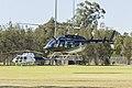 United Aero Helicopters (VH-UAI) Bell 206L-3 LongRanger III landing at an oval at Hammondville Park.jpg