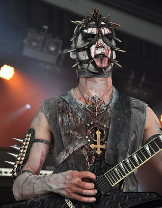 Corpse paint - Enzifer of Urgehal wearing corpse paint with the spiked armbands and inverted crosses commonly worn by black metal musicians