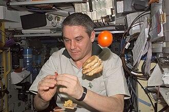 Valery Korzun - Valery Korzun prepares to eat a meal in the Zvezda Module on the ISS.
