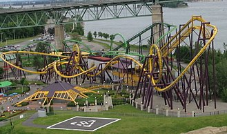 La Ronde (amusement park) - Le Vampire (yellow) with the now shut down Cobra (green) in the background, as viewed from the Grande Roue