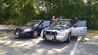 Virginia State Police - The Virginia State Police are having a lunch break at Santini's right at Oakton, VA (in Fairfax County).  One of them drives the Impala and the other drives the Crown Victoria.
