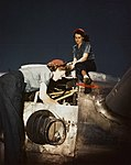 WAVES working on an R-2000 engine of a Douglas R5D at Naval Air Station Oakland, in 1945 (80-G-K-6095).jpg