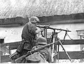"Waffen-SS soldiers from ""Wiking"" Division with MG 34 and Kar98k in soviet village.jpg"