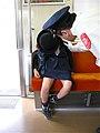 Waking up a sleeping schoolchild in a train.jpg