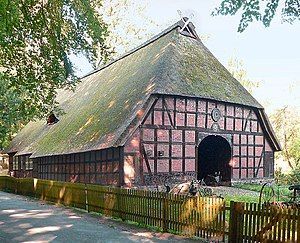 Low German house - The Rischmannshof Heath Museum, a thatched Low German house with a hipped gable roof and carved horse's heads atop the gable
