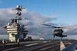 Washington Army National Guard Black Hawks land, take off on USS John C. Stennis 151120-N-GZ947-016.jpg