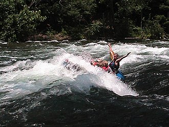 "Watauga River - Raft guide, Trey Boggs, plunging whitewater rafters downstream through ""The Big Hole"" in the Bee Cliff Rapids"