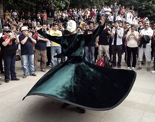Whirling Sufi Protester wearing gas mask in Gezi Park