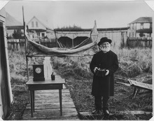 William Duncan late in life, exhibiting to friends for photographing the canvas, hammock, clock, water bottle, and... - NARA - 297897.tif