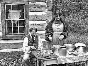 Norwegian Americans - A re-enactment of Norwegian farmers making head cheese in Wisconsin.