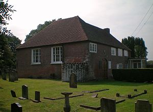 Bethel Strict Baptist Chapel, Wivelsfield - The low brick building has a hipped roof.