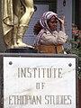 Woman Worker with Institute of Ethiopian Studies Plaque - Addis Ababa University - Addis Ababa - Ethiopia (8667489553).jpg