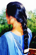Woman with a braided her Nepal.jpg