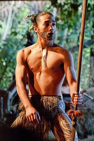 Kapa haka - Young Māori man with taiaha