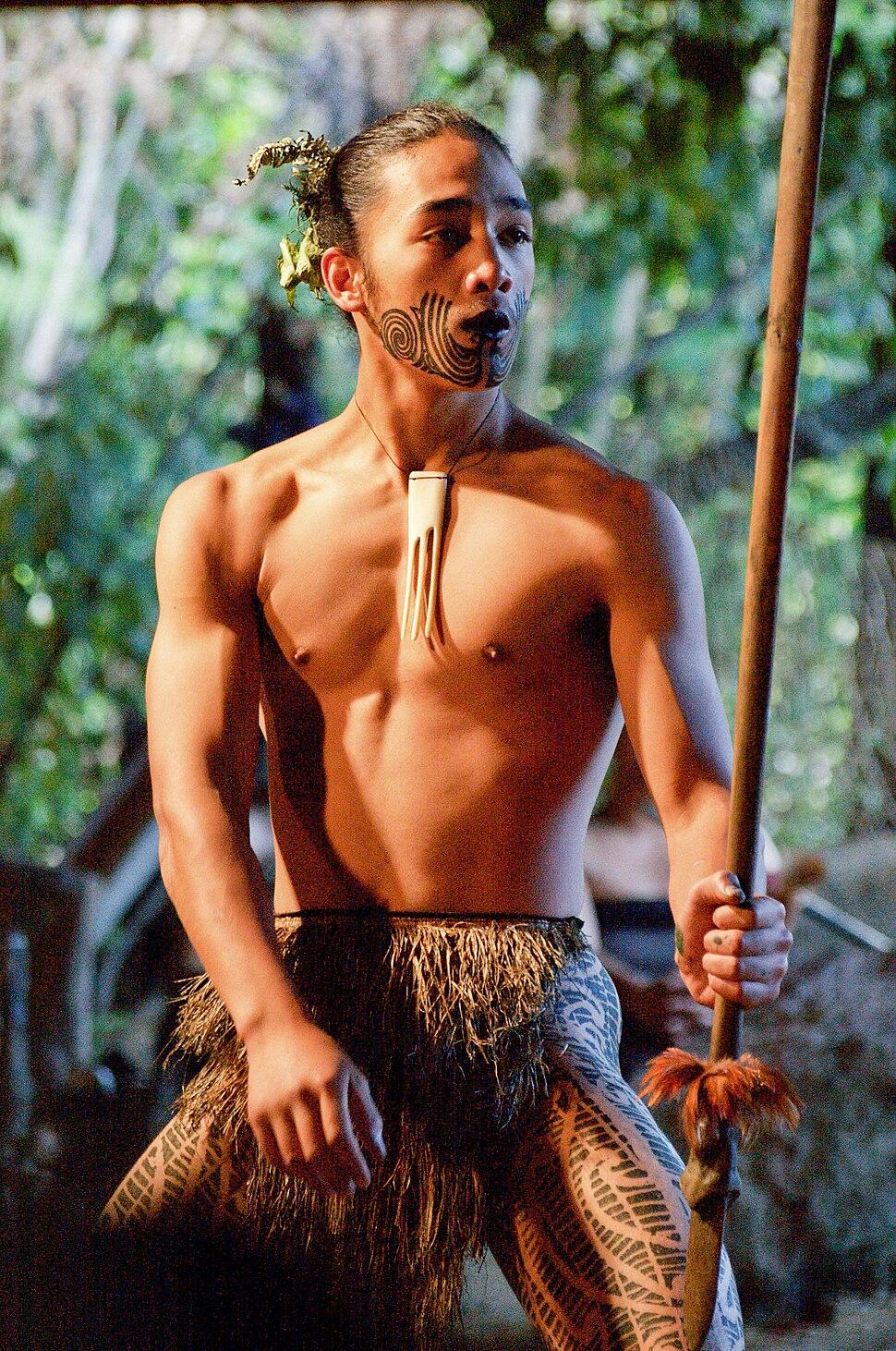 Young Maori man dancing