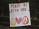 """Peace be with you"" poster at Christchurch mosque shooting memorial, Thursday 21 March 2019.jpg"