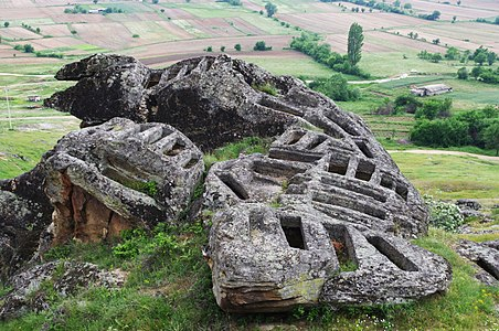 Stone tombs and a rock in the shape of lizard, Marko's Towers, Prilep, Macedonia
