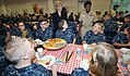 091002-N-IK959-020 - U.S. sailors listen to Patricia Adams, left, the deputy assistant secretary of the Navy for civilian human resources, and Capt. Annie B. Andrews, the executive assistant and Naval aide, talk during pizza night.jpg