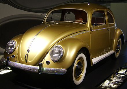 The Volkswagen Beetle was an icon of post-war West German reconstruction. The pictured example was a one-off version manufactured to celebrate the production of a million cars of the type. 1000000th beatle.jpg