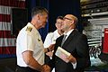 100630-N-GI380-365 Vice Adm. Dean McFadden, left, Canada's Chief of Maritime Staff, presents a book.JPG