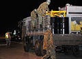 110317-F-YC711-118 JGSDF loaded pumps provided by USN onto truck.jpg