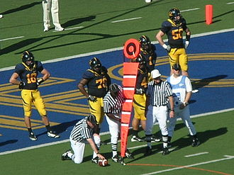 Chain crew - A first down measurement during a game between the USC Trojans and the California Golden Bears.