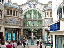 Elaborately decorated shopping mall with stained glass windows